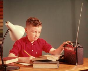1960s BOY LISTENING RADIO...